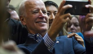 Vice President Joe Biden takes a selfie with Nevada Lt. Gov. Democratic candidate Lucy Flores during a rally in support of Nevada Democrats at the Plumbers and Pipefitters Joint UA Local 525 in Las Vegas Saturday, Nov. 1, 2014. (AP Photo/Las Vegas Sun, L.E. Baskow) ** FILE **