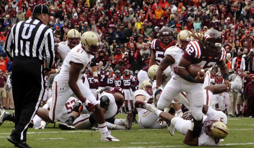 Virginia Tech running back Marshawn Williams (42) scores a first quarter touchdown over Boston College's Ty-Meer Brown (5) during an NCAA college football game Saturday, Nov. 1, 2014, in Blacksburg Va. (AP Photo/The Roanoke Times, Matt Gentry)  LOCAL TELEVISION OUT; SALEM TIMES REGISTER OUT; FINCASTLE HERALD OUT;  CHRISTIANBURG NEWS MESSENGER OUT; RADFORD NEWS JOURNAL OUT; ROANOKE STAR SENTINEL OUT