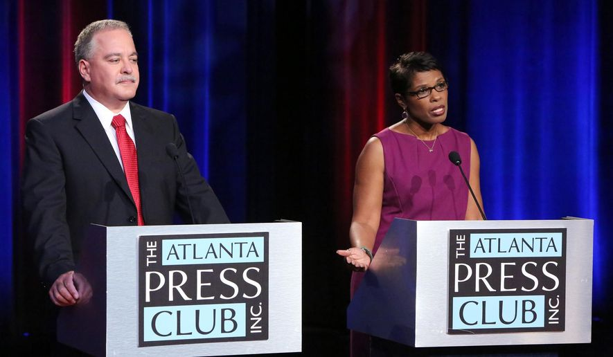 FILE - In this Oct. 12, 2014 file photo, Republican Richard L. Woods, left, and Democrat Valarie Wilson square off once again during a Atlanta Press Club sponsored debate as they campaign to be Georgia's next superintendent at the Georgia Public Broadcasting studios in Atlanta.  Republicans are running to defend offices from lieutenant governor to insurance commissioner four years after the GOP for the first time swept up control of every statewide office in Georgia.  With no incumbent on the ballot, the race for Georgia school superintendent gives Democrats their best odds of taking back a statewide office. (AP Photo/Atlanta Journal-Constitution, Phil Skinner)