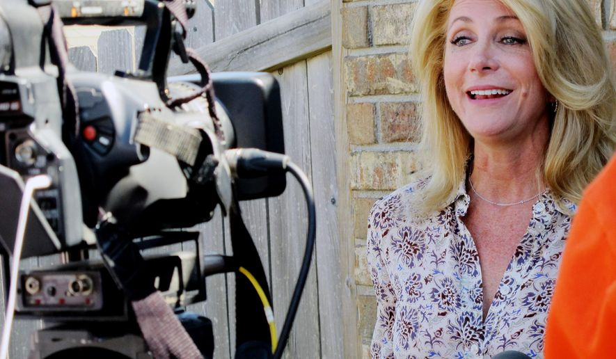 Texas Democratic gubernatorial nominee Wendy Davis is interviewed before a block-walking session on Saturday, October 25, 2014, in Killeen, Texas. A state senator from Fort Worth, Davis is a decided underdog in a fiercely conservative state, but even if she losses, the election may have more name-recognition and future appeal than many other unsuccessful candidates elsewhere in the country. (AP Photo/Will Weissert)