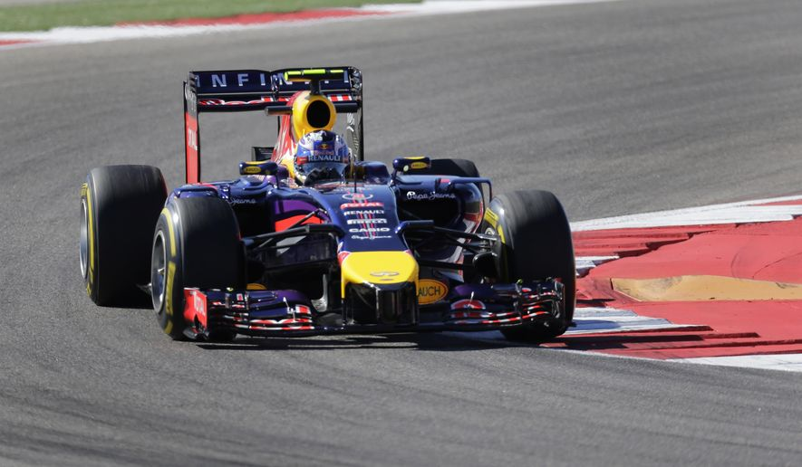 Red Bull driver Daniel Ricciardo, of Australia, drives through a turn during the second practice session for the Formula One U.S. Grand Prix auto race at the Circuit of the Americas, Friday, Oct. 31, 2014, in Austin, Texas. (AP Photo/Eric Gay)