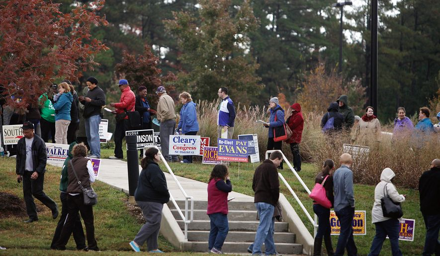 A line of early voters winds down the sidewalk in front of the South Regional Library, an early voting site, Saturday, Nov. 1, 2014 in Durham, N.C. Some voters waited in line for nearly two hours to cast their ballots on the last day of early voting. (AP Photo/The Herald-Sun, Christine T. Nguyen)