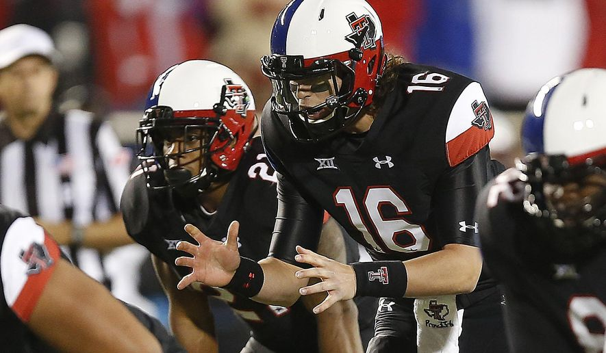 Texas Tech's Vincent Testaverde (16) prepares to take snap during an NCAA college football game against Texas in Lubbock, Texas, Saturday, Nov. 1, 2014. (AP Photo/Lubbock Avalanche-Journal/Tori Eichberger)