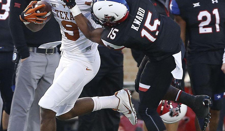 Texas' John Harris tries to get past Texas Tech's Keenon Ward during an NCAA college football game in Lubbock, Texas, Saturday, Nov. 1, 2014. (AP Photo/Lubbock Avalanche-Journal, Tori Eichberger)