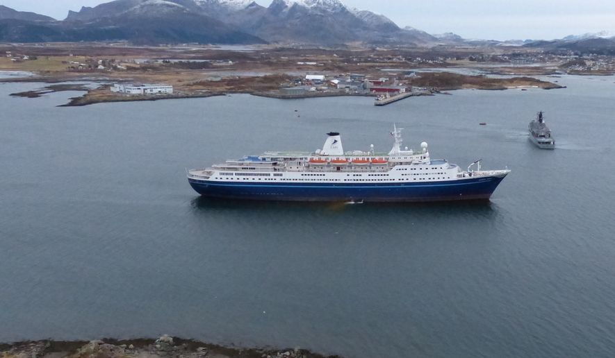 "This image made available by the Royal Norwegian Air Force taken from a rescue helicopter shows a Norwegian coast guard vessel, right, behind the  Bahamas-registered cruise liner ""Marco Polo"" aground near Gravdal in northern Norway, Saturday Nov. 1, 2014. Passengers had been allowed to leave the cruise ship, which was carrying more than a thousand people when it ran aground in the Lofoten archipelago early Saturday. The same liner also ran aground briefly in a nearby archipelago in March, according to Norwegian media. The cause of that incident remained unclear. (AP Photo/Royal Norwegian Air Force) NORWAY OUT"