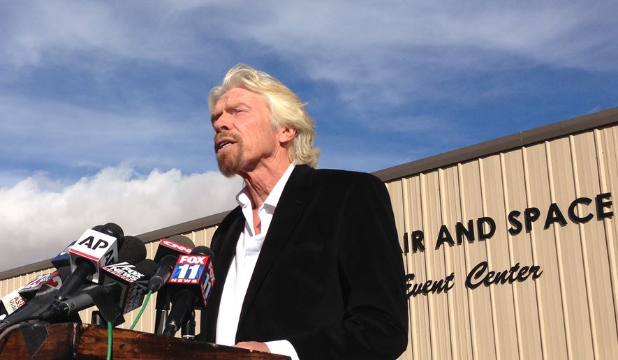 Billionaire Virgin Galactic founder Richard Branson salutes the bravery of test pilots, and vows to find out what caused the crash of his prototype space tourism rocket that killed one crew member and injured another during a news conference in Mojave, Calif., Saturday, Nov. 1, 2014.  Virgin Galactic's SpaceShipTwo blew apart about 20 miles (32 kilometers) from the Mojave airfield after being released from a carrier aircraft Friday. (AP Photo/Brian Melley)
