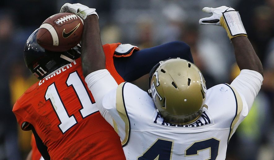 Georgia Tech defensive end KeShun Freeman (42) strips the ball from Virginia quarterback Greyson Lambert (11) during the first half of an NCAA college football game, Saturday, Nov. 1, 2014, in Atlanta. (AP Photo/Mike Stewart)