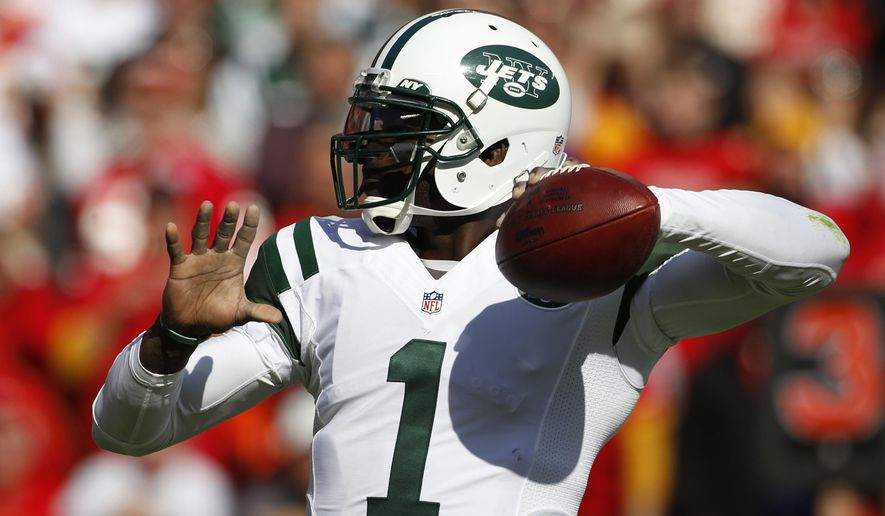 New York Jets quarterback Michael Vick (1) throws in the first half of an NFL football game against the Kansas City Chiefs in Kansas City, Mo., Sunday, Nov. 2, 2014. (AP Photo/Colin E. Braley)