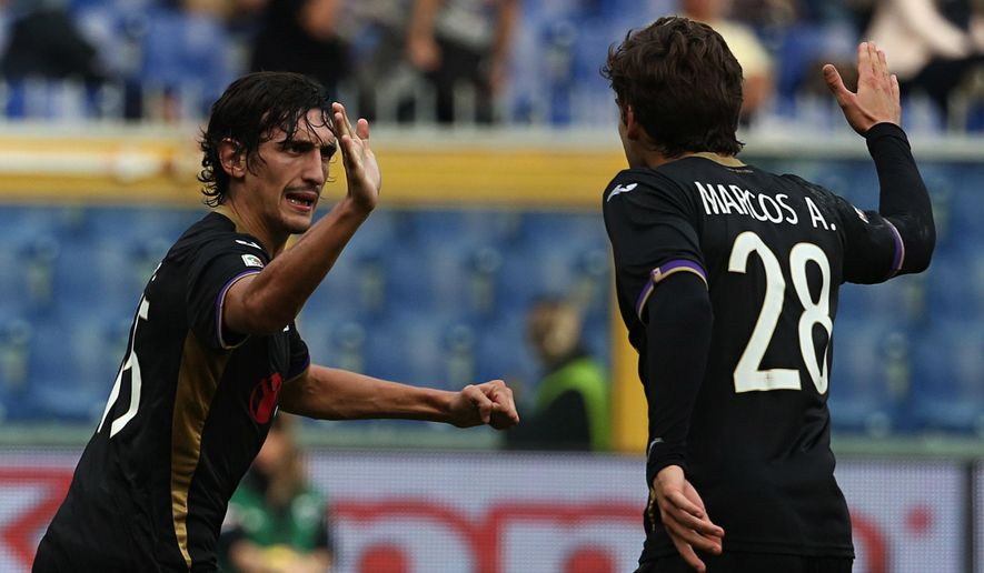 Fiorentina defender Stefan Savic, left, celebrates with his teammate Mendoza Marcos Alonso after scoring during a Serie A soccer match between Sampdoria and Fiorentina, in Genoa, Italy, Sunday, Nov. 2, 2014. (AP Photo/Carlo Baroncini)