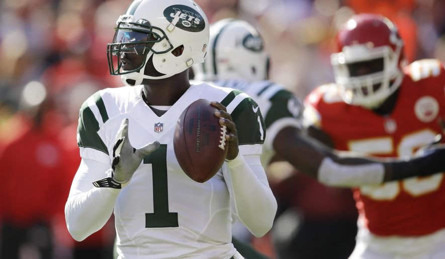 New York Jets quarterback Michael Vick (1) looks to pass the ball in the first half of an NFL football game against the Kansas City Chiefs in Kansas City, Mo., Sunday, Nov. 2, 2014. (AP Photo/Orlin Wagner)