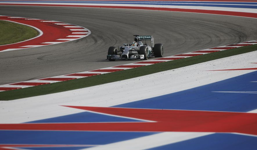 Mercedes driver Lewis Hamilton, of Britain, drives his car around a corner during the Formula One U.S. Grand Prix auto race at the Circuit of the Americas, Sunday, Nov. 2, 2014, in Austin, Texas. (AP Photo/David J. Phillip)