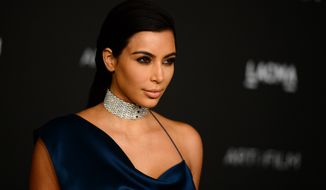 Kim Kardashian arrives at the LACMA Art + Film Gala at LACMA on Saturday, Nov. 1, 2014, in Los Angeles. (Photo by Jordan Strauss/Invision/AP)