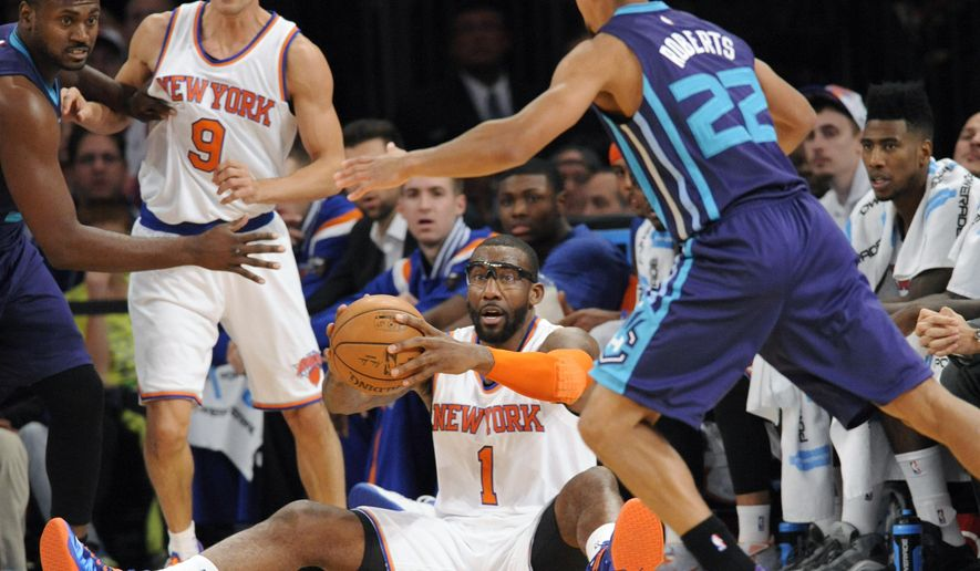 New York Knicks' Amar'e Stoudemire (1) looks to pass the ball as he is pressured by Charlotte Hornets' Brian Roberts (22) during the first half of an NBA basketball game Sunday, Nov. 2, 2014, in New York. (AP Photo/Bill Kostroun)