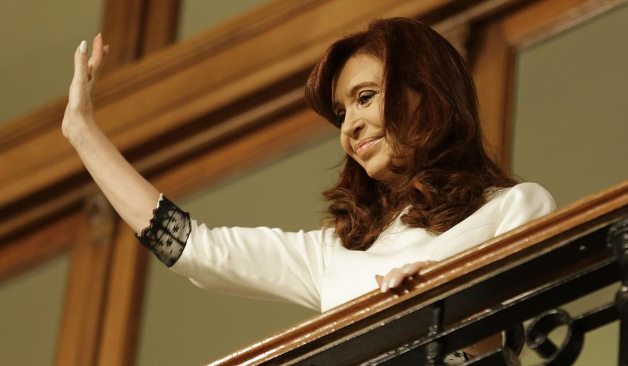 FILE - In this July 31, 2014, file photo, Argentine President Cristina Fernandez waves to supporters after giving a second speech at Casa Rosada Presidential Palace in Buenos Aires, Argentina. Health officials in Argentina said Sunday Nov, 2, 2014, that President Fernandez has been hospitalized with an infectious fever. (AP Photo/Victor R. Caivano, File)