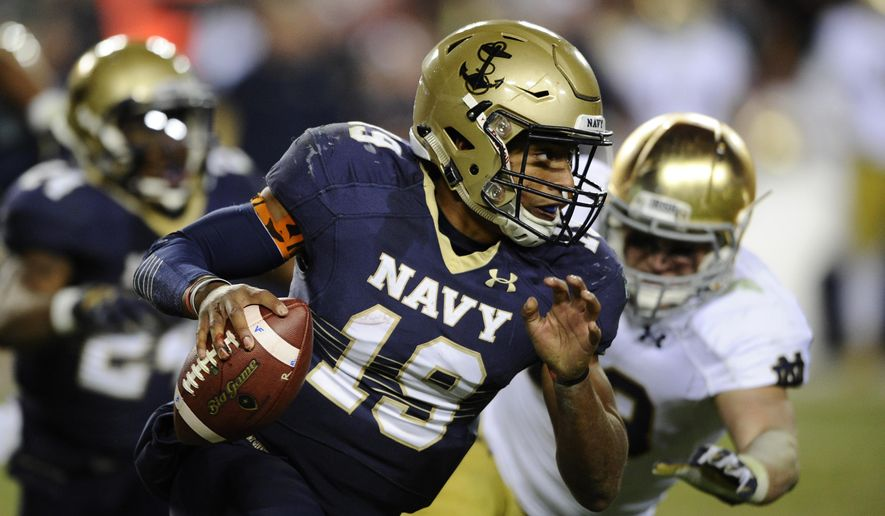 Navy quarterback Keenan Reynolds (19) runs with the ball against Notre Dame during the second half of an NCAA college football game, Saturday, Nov. 1, 2014, in Landover, Md. Notre Dame won 49-39. (AP Photo/Nick Wass)