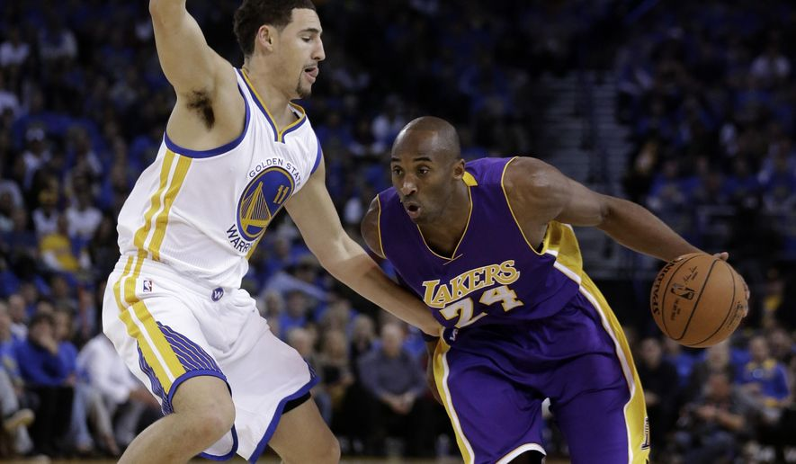 Los Angeles Lakers' Kobe Bryant, right, drives the ball against Golden State Warriors' Klay Thompson (11) during the first half of an NBA basketball game Saturday, Nov. 1, 2014, in Oakland, Calif. (AP Photo/Ben Margot)