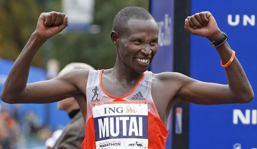 FILE - Geoffrey Mutai of Kenya celebrates his first place win in the men's division of the New York City Marathon, in this Nov. 3, 2013 file photo taken in New York. He seeks to become the first man to win three straight NYC Marathon titles since Alberto Salazar from 1980-82. (AP Photo/Kathy Willens, File)