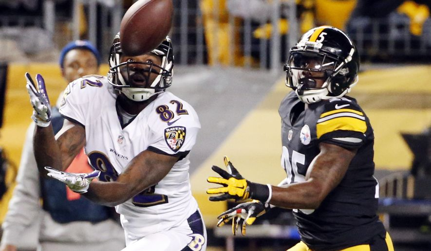 Baltimore Ravens wide receiver Torrey Smith (82) makes a touchdown catch past Pittsburgh Steelers cornerback Brice McCain (25) in the first quarter of the NFL football game, Sunday, Nov. 2, 2014, in Pittsburgh. (AP Photo/Gene Puskar)