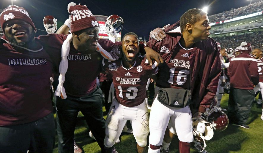 Mississippi State running back Josh Robinson (13) and some teammates celebrate their victory over Arkansas in their NCAA college football game in Starkville, Miss., Saturday, Nov. 1, 2014. No. 1 Mississippi State won 17-10. (AP Photo/Rogelio V. Solis)