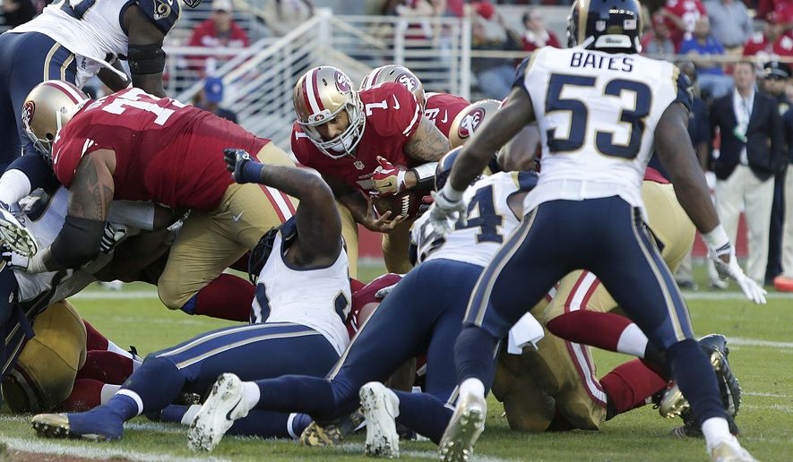 San Francisco 49ers quarterback Colin Kaepernick (7) runs before losing a fumble against the St. Louis Rams during the fourth quarter of an NFL football game in Santa Clara, Calif., Sunday, Nov. 2, 2014. The Rams won 13-10. (AP Photo/Marcio Jose Sanchez)