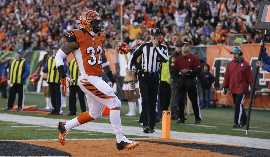 Cincinnati Bengals running back Jeremy Hill runs in for a touchdown against the Jacksonville Jaguars during the second half of an NFL football game in Cincinnati, Sunday, Nov. 2, 2014. (AP Photo/David Kohl)