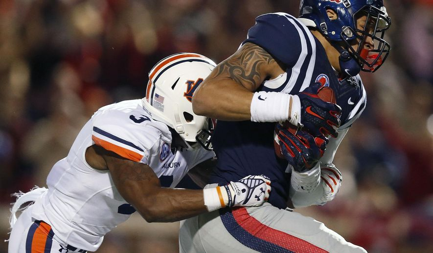 Mississippi tight end Evan Engram (17) scores a touchdown against Auburn defensive back Jonathan Jones (3) during the second half of an NCAA college football game, Saturday, Nov. 1, 2014, in Oxford, Miss. (AP Photo/Brynn Anderson)