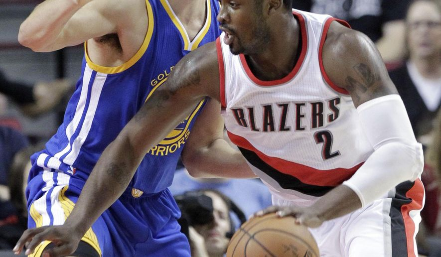 Portland Trail Blazers guard Wesley Matthews, right, drives on Golden State Warriors guard Klay Thompson during the first half of an NBA basketball game in Portland, Ore., Sunday, Nov. 2, 2014. (AP Photo/Don Ryan)