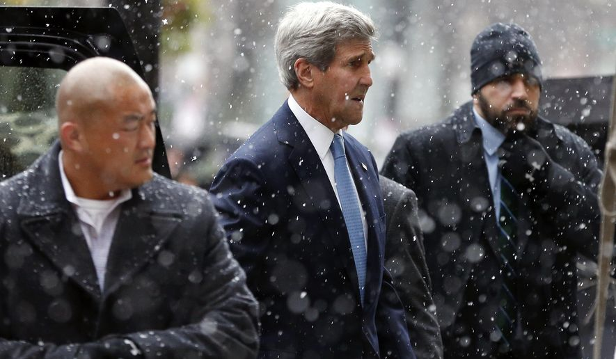 Secretary of State John Kerry, center, arrives for the wake of former Boston Mayor Thomas Menino at Faneuil Hall in Boston, Sunday, Nov. 2, 2014. Menino, who served for more than 20 years, died Thursday at the age of 71. (AP Photo/Michael Dwyer)