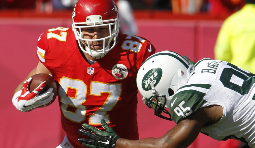Kansas City Chiefs tight end Travis Kelce (87) is tackled by New York Jets linebacker Antwan Barnes (95) in the first half of an NFL football game in Kansas City, Mo., Sunday, Nov. 2, 2014. (AP Photo/Colin E. Braley)