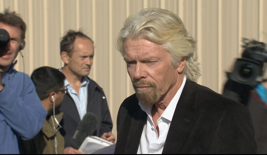 In this video grabbed image, billionaire Virgin Galactic founder Richard Branson,  pauses before a news conference in which he saluted the bravery of test pilots, and vowed to find out what caused the crash of his prototype space tourism rocket that killed one crew member and injured another in Mojave, Calif., Saturday, Nov. 1, 2014. Virgin Galactic's SpaceShipTwo blew apart about 20 miles (32 kilometers) from the Mojave airfield after being released from a carrier aircraft Friday. (AP Photo/Scott Fain)