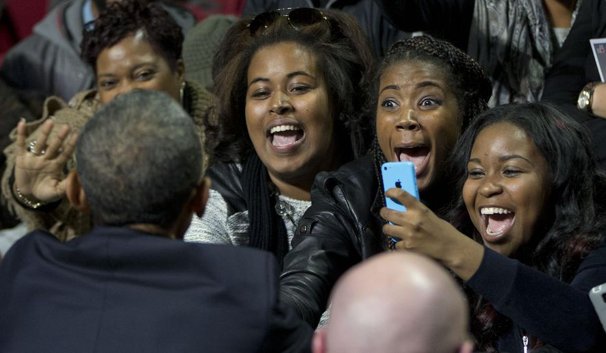 Supporters react to greeting President Barack Obama, left, during a campaign event for gubernatorial candidate Tom Wolf at Temple University in Philadelphia, Pa., Sunday, Nov. 2, 2014. (AP Photo/Pablo Martinez Monsivais)