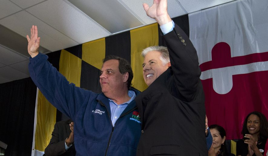 Republican gubernatorial candidate Larry Hogan, right,  and New Jersey Republican Governor Chris Christie rises their hands during a campaign rally  at Patapsco Arena, in Baltimore, Md., on Sunday, Nov. 2, 2014. Christie is chairman of the Republican Governors Association and came to Maryland in support of Republican gubernatorial candidate Larry Hogan. (AP Photo/Jose Luis Magana)