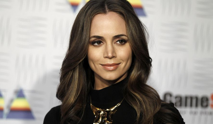 FILE - In this Dec. 11, 2010 file photo, Eliza Dushku, famous for roles in Buffy the Vampire Slayer. Dushku is an elk hunter, but not longer speaks publicly about her hunts after being pestered by anti-hunting activists.
