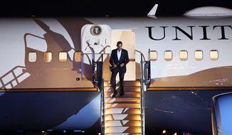 President Barack Obama exits Air Force One after arriving at Philadelphia International Airport in Philadelphia on Sunday Nov. 2, 2014. (AP Photo/ Joseph Kaczmarek)