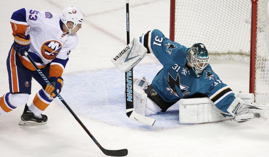 San Jose Sharks goalie Antti Niemi (31), of Finland, stops a shot next to New York second period of an NHL hockey game Saturday, Nov. 1, 2014, in San Jose, Calif. (AP Photo/Marcio Jose Sanchez)