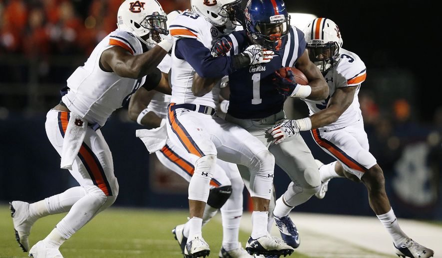 Mississippi wide receiver Laquon Treadwell (1) is taken down by Auburn's defense during the second half of an NCAA college football game, Saturday, Nov. 1, 2014, in Oxford, Miss. (AP Photo/Brynn Anderson)