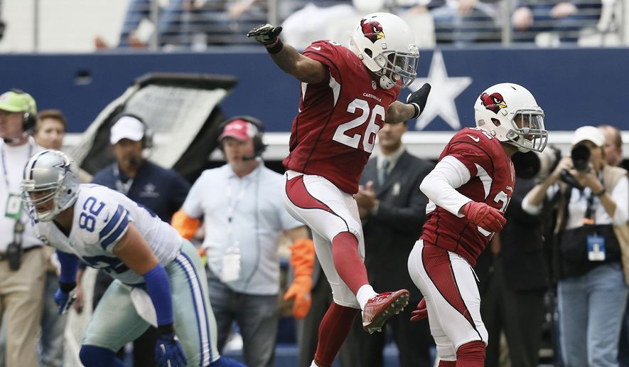 After making an interception against the Dallas Cowboys, Arizona Cardinals free safety Tyrann Mathieu (32) celebrates with free safety Rashad Johnson (26) during the second half of an NFL football game Sunday, Nov. 2, 2014, in Arlington, Texas. (AP Photo/Brandon Wade)
