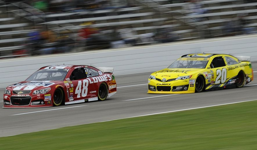 Jimmie Johnson (48) drives against Matt Kenseth (20) during the NASCAR Sprint Cup Series auto race at Texas Motor Speedway in Fort Worth, Texas, Sunday, Nov. 2, 2014. (AP Photo/Ralph Lauer)