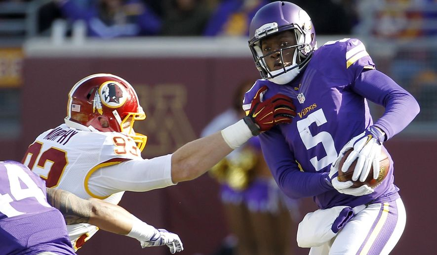 Minnesota Vikings quarterback Teddy Bridgewater breaks a tackle by Washington Redskins linebacker Trent Murphy during the first half of an NFL football game, Sunday, Nov. 2, 2014, in Minneapolis. (AP Photo/Ann Heisenfelt)