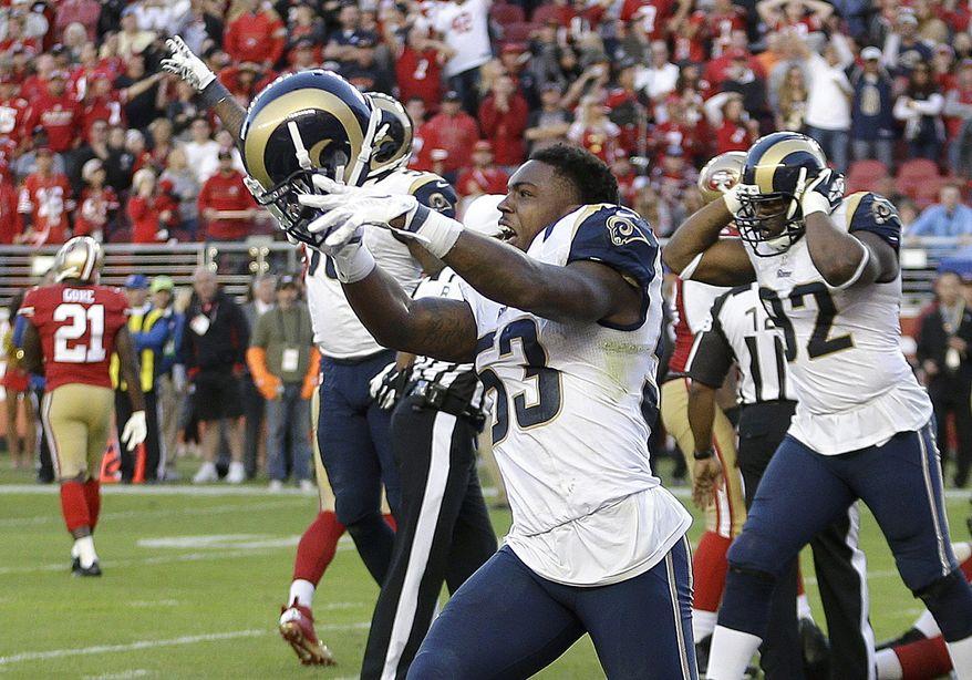 St. Louis Rams linebacker Daren Bates (53) celebrates after the Rams recovered a fumble by San Francisco 49ers quarterback Colin Kaepernick during the fourth quarter of an NFL football game in Santa Clara, Calif., Sunday, Nov. 2, 2014. The Rams won 13-10. (AP Photo/Ben Margot)