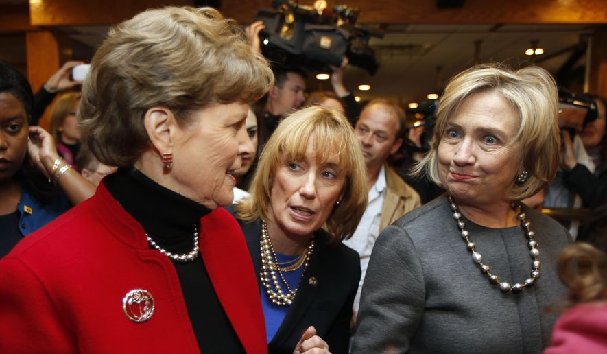 Hillary Rodham Clinton, right, greets voters with, U.S. Sen. Jeanne Shaheen, D-N.H., far left and Gov. Maggie Hassan, D-N.H., center at the puritan Backroom Restaurant, Sunday, Nov. 2, 2014 in Manchester, N.H. (AP Photo/Jim Cole)