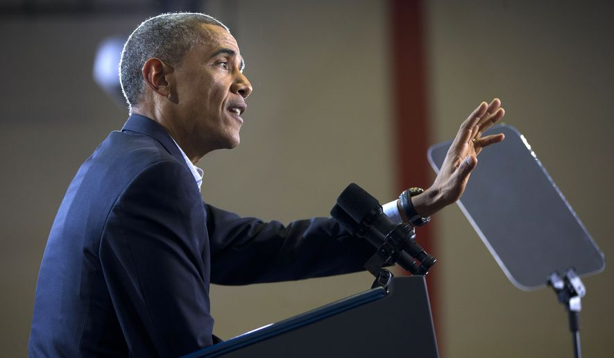 President Barack Obama gestures as he pauses during his speech to respond to a heckler in the audience during a campaign event for gubernatorial candidate Dan Malloy at Central High School in Bridgeport, Conn., Sunday, Nov. 2, 2014. (AP Photo/Pablo Martinez Monsivais)