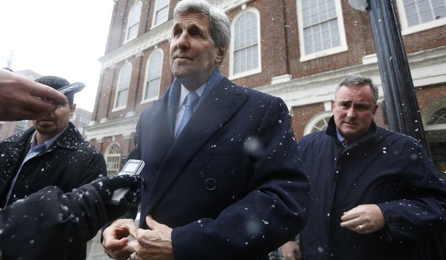 Secretary of State John Kerry speaks with reporters after attending the wake for former Boston Mayor Thomas Menino at Faneuil Hall in Boston, Sunday, Nov. 2, 2014. Menino, who served for more than 20 years, died Thursday at the age of 71. (AP Photo/Michael Dwyer)