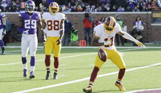 Washington Redskins wide receiver DeSean Jackson (11) celebrates after catching a 13-yard touchdown pass during the second half of an NFL football game against the Minnesota Vikings, Sunday, Nov. 2, 2014, in Minneapolis. (AP Photo/Ann Heisenfelt)