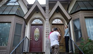 In a final campaign push, Georgia U.S. Senate Democratic candidate Michelle Nunn rings a doorbell Monday while canvassing a neighborhood for voter support with daughter Elizabeth Martin and volunteer Connor Stubbs. (Associated Press)