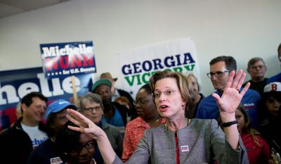 on her mind: Georgia Senate Democratic candidate Michelle Nunn rallies support against the GOP's David Perdue.