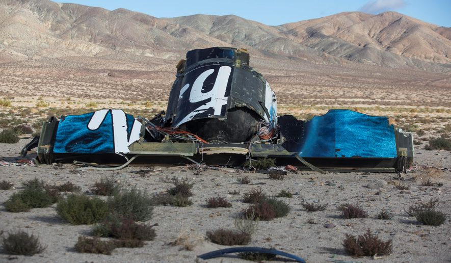 A Virgin Galactic space tourism rocket exploded and crashed in California Saturday, killing a pilot aboard and seriously injuring another while scattering wreckage in the Mojave Desert, witnesses and officials said. (Associated Press)
