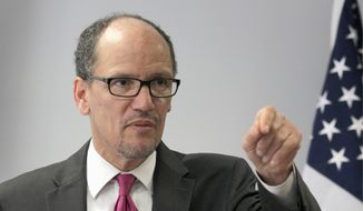 This photo taken June 4, 2014, shows Labor Secretary Thomas Perez speaking in Washington. (AP Photo/Connor Radnovich) ** FILE **
