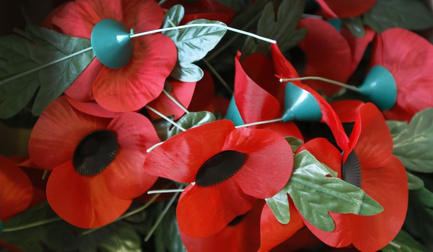 Finished poppies lie in a box after being constructed at the Poppy Factory in Richmond near London, Thursday, Sept. 25, 2014. The factory makes the bulk of the 45 million poppies, wreaths and crosses sold across Britain to this day. (AP Photo/Kirsty Wigglesworth) **FILE**
