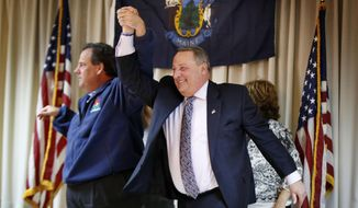 New Jersey Gov. Chris Christie, left, and Maine Gov. Paul LePage, acknowledge applause at a campaign rally for LePage, Monday, Nov. 3, 2014, in Portland, Maine. LePage is being challenged by Democrat Mike Michaud and independent Elliot Cutler. (AP Photo/Robert F. Bukaty)